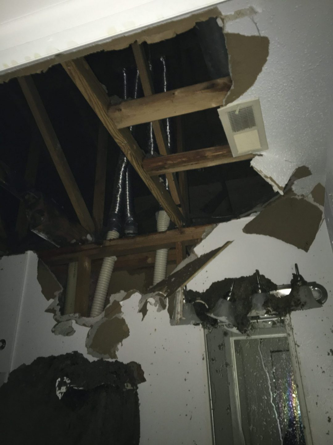 a picture of a hole in a ceiling at a commercial water damage project
